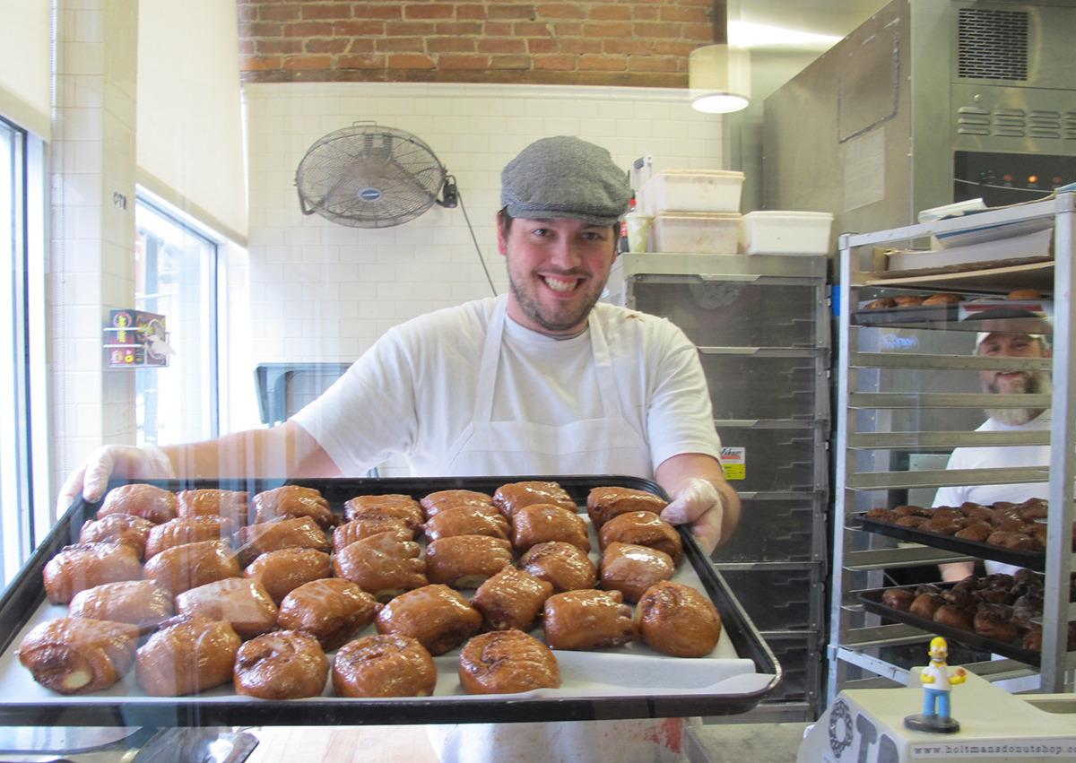 """<p>This family-owned shop has <a href=""""http://www.holtmansdonutshop.com/"""">three branches</a> in the Cincinnati area, and has decadent flavors like Maple Bacon and Lucky Charms.</p>"""