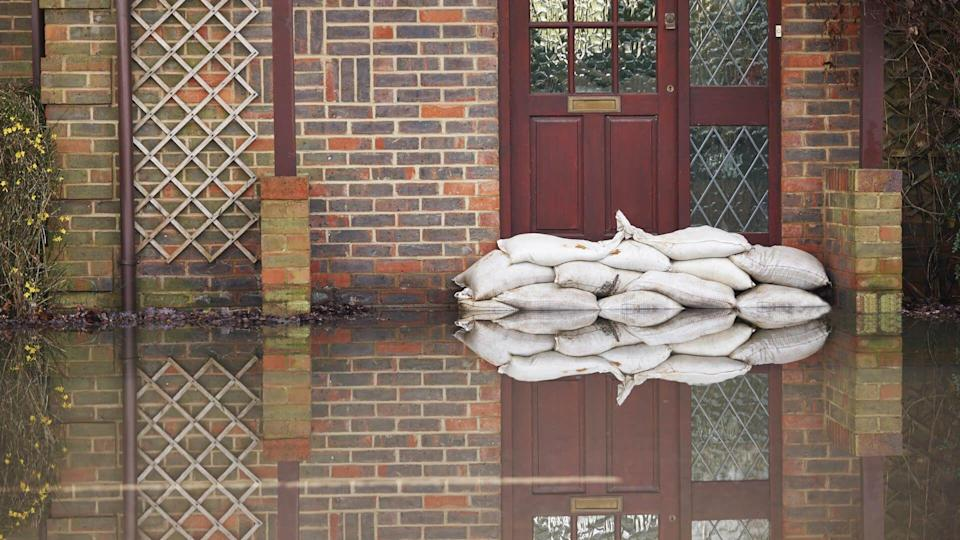 Sandbags Outside Front Door Of Flooded House - Image.