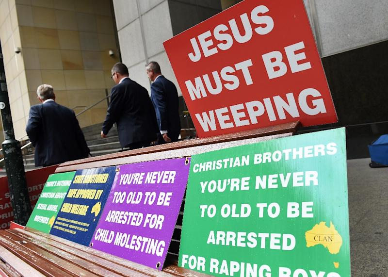 Placards outside the Royal Commission into Institutional Responses to Child Sexual Abuse in Sydney on March 1, 2016 (AFP Photo/William West)