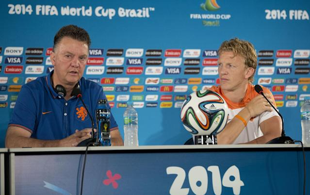 Netherlands head coach Louis van Gaal, left, speaks as player Dirk Kuyt looks on during a news conference at the Estadio Nacional in Brasilia, Brazil, Friday, July 11, 2014. The Netherlands will face Brazil in the World Cup third-place match Saturday. (AP Photo/Andre Penner)