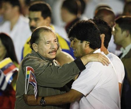 Daniel Ortega hugs Evo Morales before the march of the torches in celebration of the 161th birth anniversary of Jose Marti in Havana