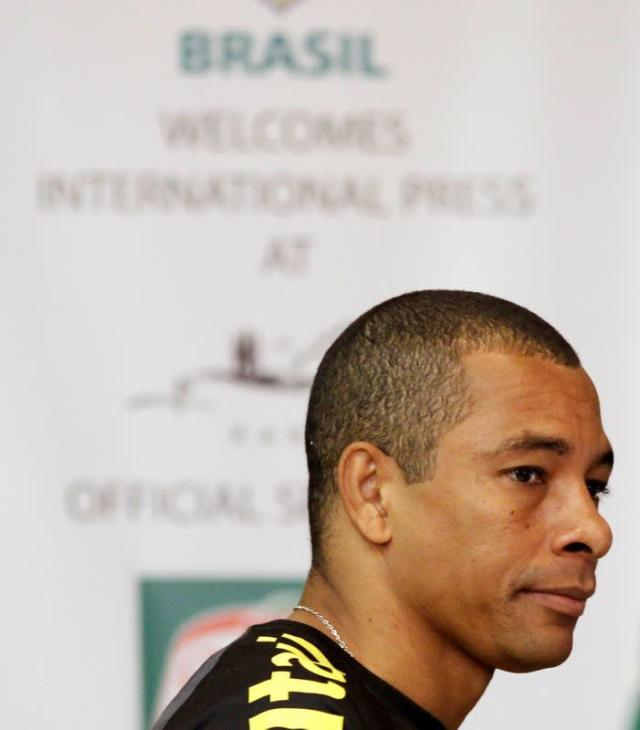 FILE PHOTO: Brazilian soccer player Gilberto Silva arrives for a news conference in Johannesburg