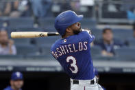 Texas Rangers' Delino DeShields hits a three-run home run during the eighth inning of a baseball game against the New York Yankees, Monday, Sept. 2, 2019, in New York. (AP Photo/Adam Hunger)