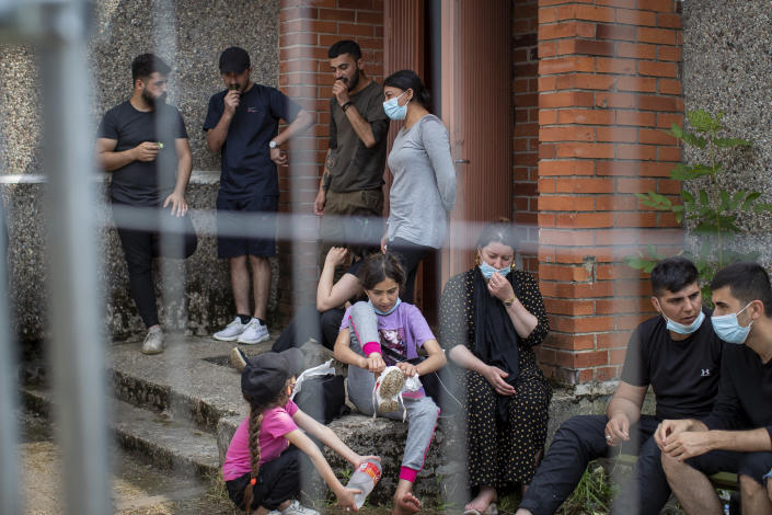 Migrants from Iraq rest at the refugee camp in the village of Verebiejai, some 145km (99,1 miles) south from Vilnius, Lithuania, Sunday, July 11, 2021. Migrants at the school in the village of Verebiejai, about 140 kilometers (87 miles) from Vilnius, haven't been allowed to leave the premises and are under close police surveillance. Some have tested positive for COVID-19 and have been isolated in the building. (AP Photo/Mindaugas Kulbis)