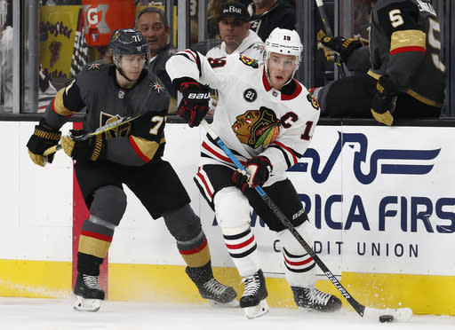 Chicago Blackhawks center Jonathan Toews (19) skates around Vegas Golden Knights center William Karlsson (71) during the second period of an NHL hockey game Thursday, Dec. 6, 2018, in Las Vegas. (AP Photo/John Locher)