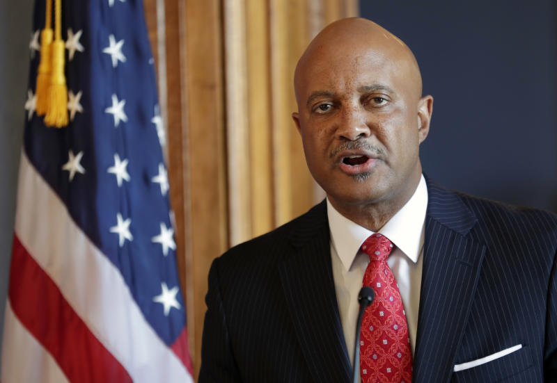 FILE - In this July 9, 2018, file photo, Indiana Attorney General Curtis Hill speaks during a news conference at the Statehouse in Indianapolis. The four women who accused Indiana's attorney general of drunkenly groping them at a party are holding a news conference with their lawyers. The law firm representing the women says an announcement is coming Tuesday, June 18, 2019, about legal action regarding the allegations against Hill. The women's lawyers said in October they intended to sue Hill, who has denied wrongdoing.  (AP Photo/Michael Conroy, File)