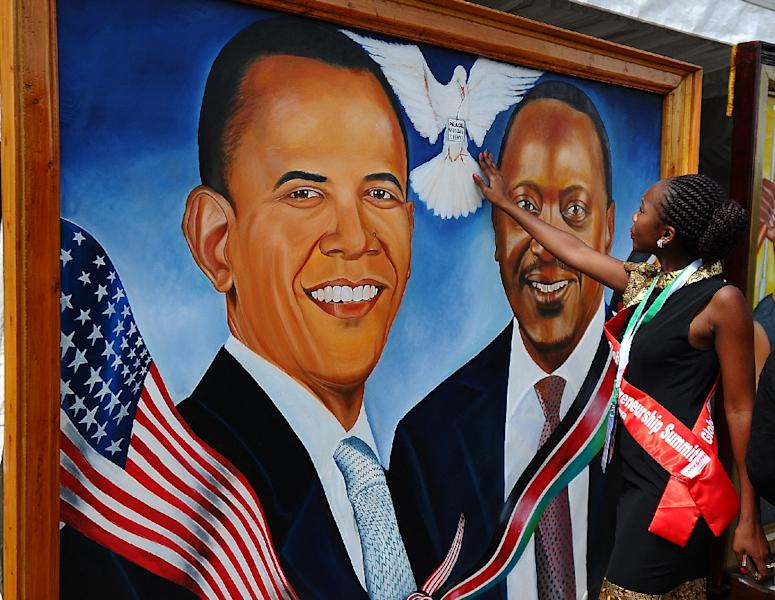 A Kenyan woman touches a painting depicting a dove between US President Barack Obama and Kenyan President Uhuru Kenyatta at Kenyatta International Convention Centre (KICC) in Nairobi on July 22, 2015 (AFP Photo/John Muchucha)