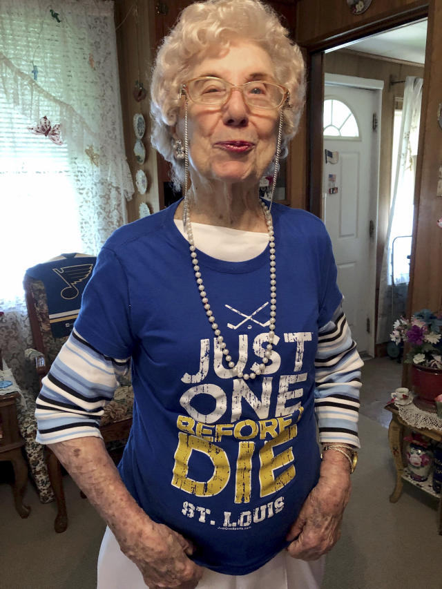 "St. Louis Blues fan Marge Kirchhoefer poses for a portrait in her St. Louis home, Thursday, June 13, 2019. At age 100, Kirchhoefer is among the oldest St. Louis Blues fans, and now that they're Stanley Cup champions, she knows exactly how she'll celebrate. She plans to drink champagne and says she ""may get loaded."" There's a lot of that going around in St. Louis, now that the Blues have knocked off the Boston Bruins to win their first NHL championship since they arrived as an expansion team 52 years ago. (AP Photo/Jim Salter)"