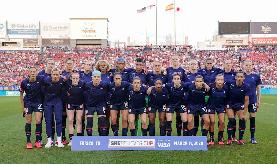 The USWNT poses together before a SheBelieves Cup game against Japan wearing their warmup tops inside out to obscure the U.S. Soccer logo. (Photo by Brad Smith/ISI Photos/Getty Images)