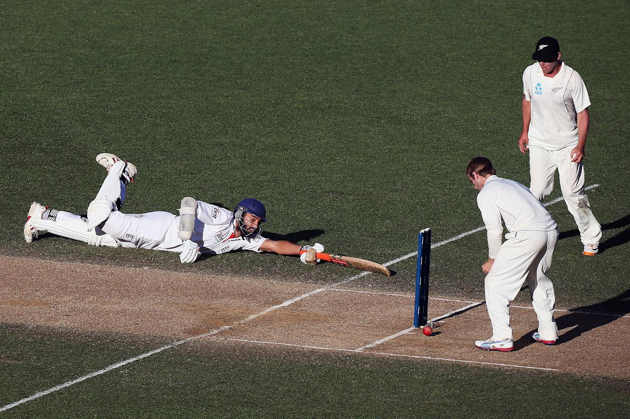 AUCKLAND, NEW ZEALAND - MARCH 26: Monty Panesar of England dives into his crease during day five of the Third Test match between New Zealand and England at Eden Park on March 26, 2013 in Auckland, New Zealand.  (Photo by Hannah Johnston/Getty Images)