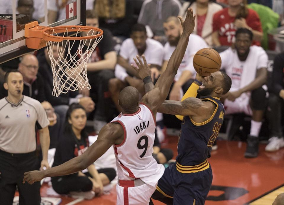 LeBron James attacks the basket against Toronto's Serge Ibaka, who will be a free agent this offseason. (AP)