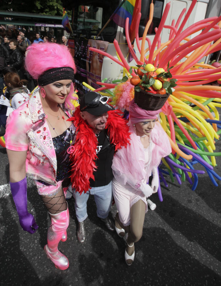 People take part in the annual Lesbian, Gay, Bisexual and Transgender equality march passing through the streets of Warsaw, Poland, Saturday, June 2, 2012. Gay rights activists held the parade as gays and lesbians become increasingly visible in this conservative mostly Catholic country but still face significant prejudice. (AP Photo/Czarek Sokolowski)