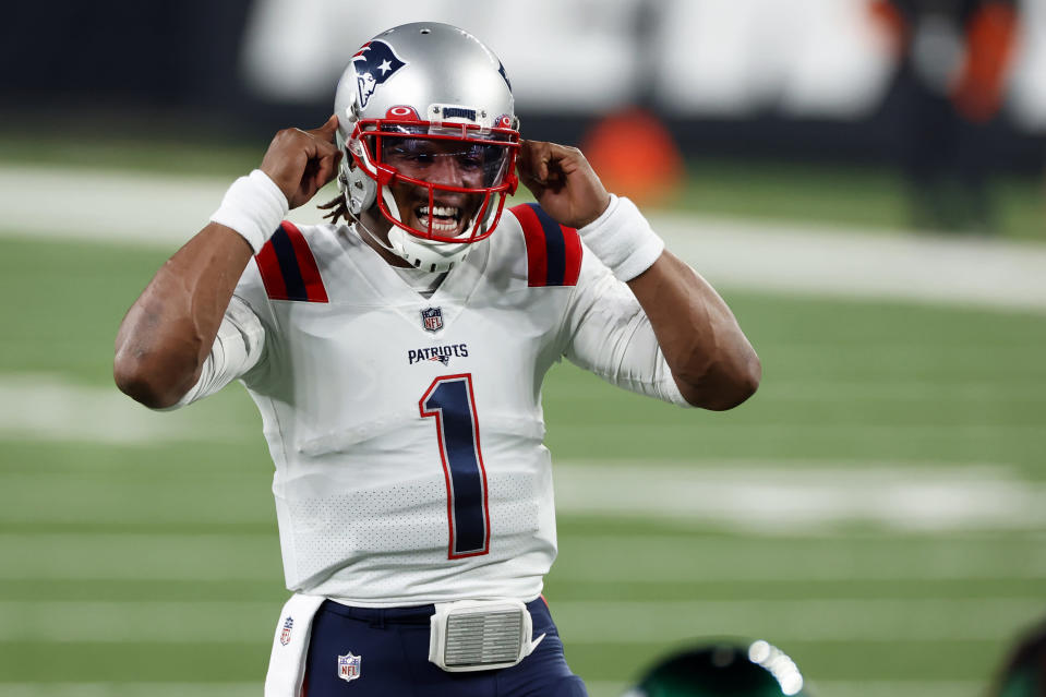 FILE - In this Nov. 9, 2020, file photo, New England Patriots quarterback Cam Newton (1) gestures at the line of scrimmage during an NFL football game against the New York Jets in East Rutherford, N.J. The college quarterbacks class is shaping up nicely, just in time to perhaps rescue some NFL teams from themselves. Those guys salivating about such prospects work in the personnel departments of the Jets, Jaguars and Bears. Maybe for the Lions, Patriots, Falcons, Saints and 49ers. (AP Photo/Adam Hunger, File)