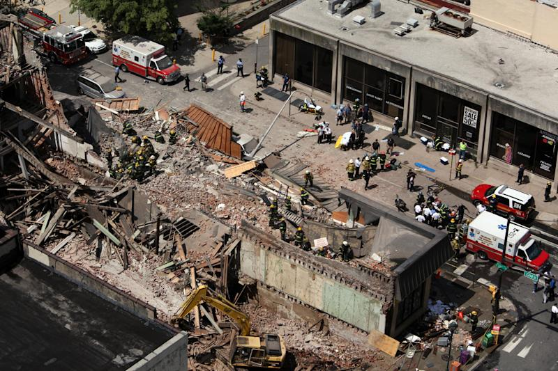 FILE - In this file photo taken June 5, 2013, rescue personnel work the scene of a building collapse on Market Street in downtown Philadelphia that left six people dead. Philadelphia District Attorney Seth Williams on Monday, Nov. 25, 2013 said that contractor Griffin T. Campbell has been charged with third-degree murder, as well as manslaughter, in connection with the collapse. (AP Photo/Jacqueline Larma, File)