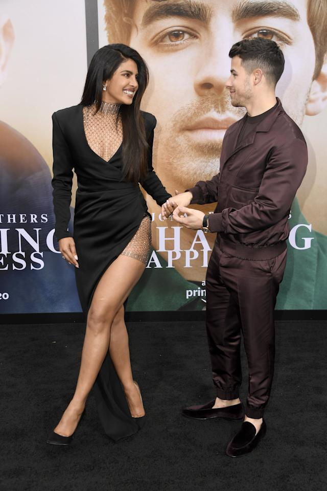"""<p>Back in June, Priyanka Chopra supported her husband, <a class=""""sugar-inline-link ga-track"""" title=""""Latest photos and news for Nick Jonas"""" href=""""https://www.popsugar.com/Nick-Jonas"""" target=""""_blank"""" data-ga-category=""""Related"""" data-ga-label=""""https://www.popsugar.com/Nick-Jonas"""" data-ga-action=""""&lt;-related-&gt; Links"""">Nick Jonas</a>, at the premiere of his Amazon documentary <strong>Chasing Happiness</strong>. The 36-year-old actress chose <a href=""""https://www.popsugar.com/fashion/Priyanka-Chopra-Dress-Chasing-Happiness-Premiere-46229311"""" class=""""ga-track"""" data-ga-category=""""Related"""" data-ga-label=""""https://www.popsugar.com/fashion/Priyanka-Chopra-Dress-Chasing-Happiness-Premiere-46229311"""" data-ga-action=""""In-Line Links"""">a sultry high-low dress for the occasion</a>, which featured a plunging neckline and fishnet detailing.</p>"""
