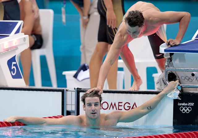 James Magnusson receives encouragement after his leg of the 4x100m freestyle relay