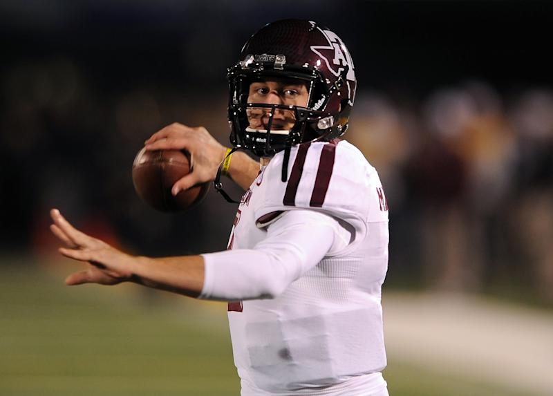 Texas A&M quarterback Johnny Manziel warms up before the start of an NCAA college football game against Missouri Saturday, Nov. 30, 2013, in Columbia, Mo. (AP Photo/L.G. Patterson)