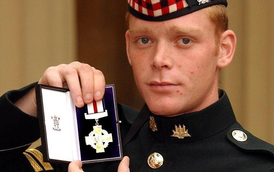 Corporal Shaun Garry Jardine of the King's Own Scottish Borderers holds his conspicuous gallantry cross - John Stillwell