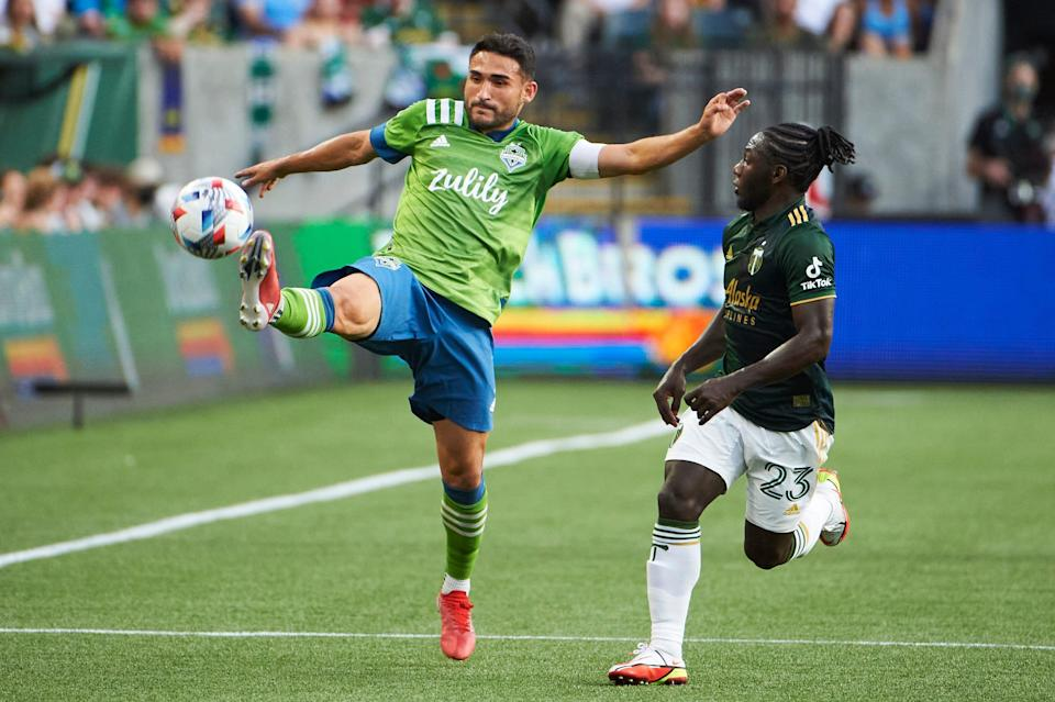 Cristian Roldan controls a pass against the Portland Timbers during the Seattle Sounders' 6-2 win at Providence Park on Sunday night.