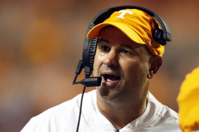FILE - In this c, Tennessee head coach Jeremy Pruitt talks to a player in the second half of an NCAA college football game against Georgia in Knoxville, Tenn. Tennessee and Indiana are both in a bowl game for the first time in three years. It's progress for respective head coaches Jeremy Pruitt and Tom Allen.  (AP Photo/Wade Payne, File)