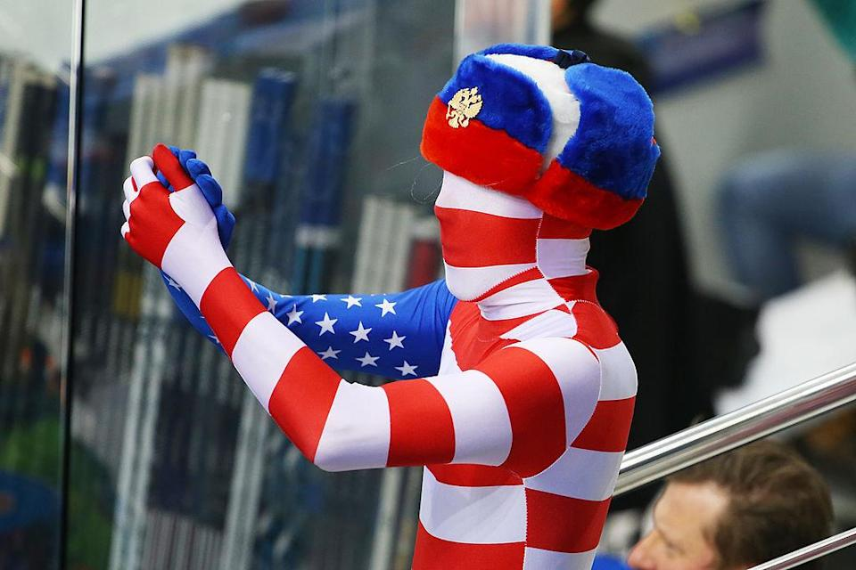 SOCHI, RUSSIA – FEBRUARY 19: A United States fan cheers on his team during the Men's Ice Hockey Quarterfinal Playoff on Day 12 of the 2014 Sochi Winter Olympics at Shayba Arena on February 19, 2014 in Sochi, Russia. (Photo by Quinn Rooney/Getty Images)