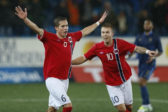 Norway's Anders Agnes Konradsen (L) celebrates scoring Norway's fourth goal with teammate Marcus Pedersen during the UEFA European Under 21 Championship Qualifying Play-Off soccer match between Norway and France at Marienlyst Stadium in Drammen, Norway, on October, 16, 2012. AFP PHOTO / SCANPIX / ERLEND AAS NORWAY OUTERLEND AAS/AFP/Getty Images