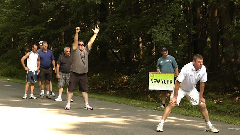 Irish road bowling players and coaches from Boston await a teammate's throw at Coopers Rock State Forest near Bruceton Mills, W.Va., on Aug. 4, 2012. (AP Photo/Vicki Smith)