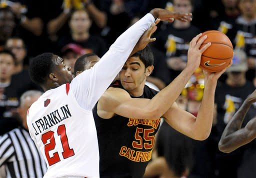 Southern California center Omar Oraby (55) battles San Diego State guard Jamaal Franklin (21) as he moves to the basket during the first half of an NCAA college basketball game, Sunday, Nov. 25, 2012, in Los Angeles. (AP Photo/Gus Ruelas)