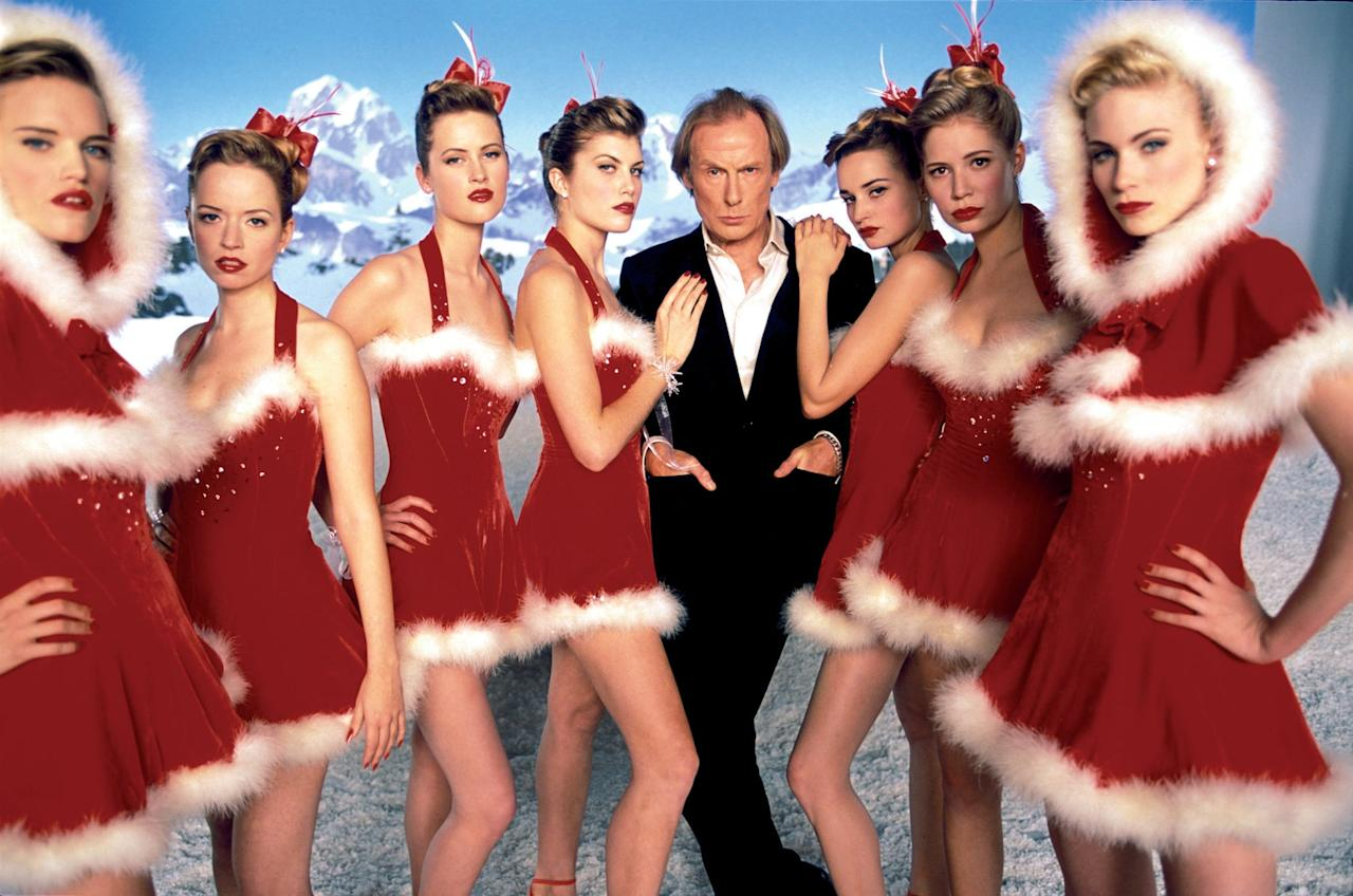 """<p>Can you feel the Christmas spirit in your fingers, or maybe your toes? Bill Nighy is a fine actor, but his performance as the slightly skeezy, washed-out rock star Billy Mack in <strong><a href=""""https://www.popsugar.com/latest/Love-Actually"""" class=""""ga-track"""" data-ga-category=""""Related"""" data-ga-label=""""http://www.popsugar.com/latest/Love-Actually"""" data-ga-action=""""In-Line Links"""">Love Actually</a> </strong>crooning """"Christmas Is All Round"""" is one that we'll never forget. And besides Billy Mack, we can't forget other musical moments in the movie like <a class=""""sugar-inline-link ga-track"""" title=""""Latest photos and news for Laura Linney"""" href=""""https://www.popsugar.com/Laura-Linney"""" target=""""_blank"""" data-ga-category=""""Related"""" data-ga-label=""""https://www.popsugar.com/Laura-Linney"""" data-ga-action=""""&lt;-related-&gt; Links"""">Laura Linney</a> getting frisky to Norah Jones's """"Turn Me On"""" or <a href=""""https://www.popsugar.com/celebrity/Emma-Thompson-Love-Actually-Scene-About-Kenneth-Branagh-44627269"""" class=""""ga-track"""" data-ga-category=""""Related"""" data-ga-label=""""http://www.popsugar.com/celebrity/Emma-Thompson-Love-Actually-Scene-About-Kenneth-Branagh-44627269"""" data-ga-action=""""In-Line Links"""">Emma Thompson getting her heart broken</a> to Joni Mitchell's """"Both Sides Now.""""</p>"""