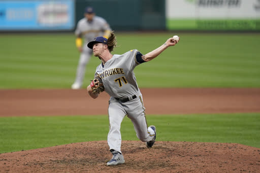 Milwaukee Brewers relief pitcher Josh Hader throws during the seventh inning in the first game of a baseball doubleheader against the St. Louis Cardinals Friday, Sept. 25, 2020, in St. Louis. (AP Photo/Jeff Roberson)