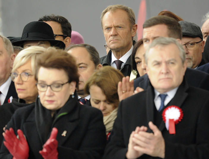 European Council President Donald Tusk, center back row, attends the official ceremony marking Poland's Independence Day, in Warsaw, Poland, Sunday, Nov. 11, 2018. Tusk joined celebrations in his native Poland on Independence Day, which celebrates the nation regaining its sovereignty at the end of World War I after being wiped off the map for more than a century. (AP Photo/Alik Keplicz)