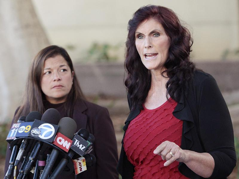 """Cindy Lee Garcia, right, one of the actresses in """"Innocence of Muslims,"""" and attorney M. Cris Armenta hold a news conference before a hearing at Los Angeles Superior Court in Los Angeles, Thursday, Sept. 20, 2012. Garcia is asking a judge to issue an injunction demanding the 14-minute trailer for """"Innocence of Muslims"""" be pulled from YouTube. (AP Photo/Jason Redmond)"""
