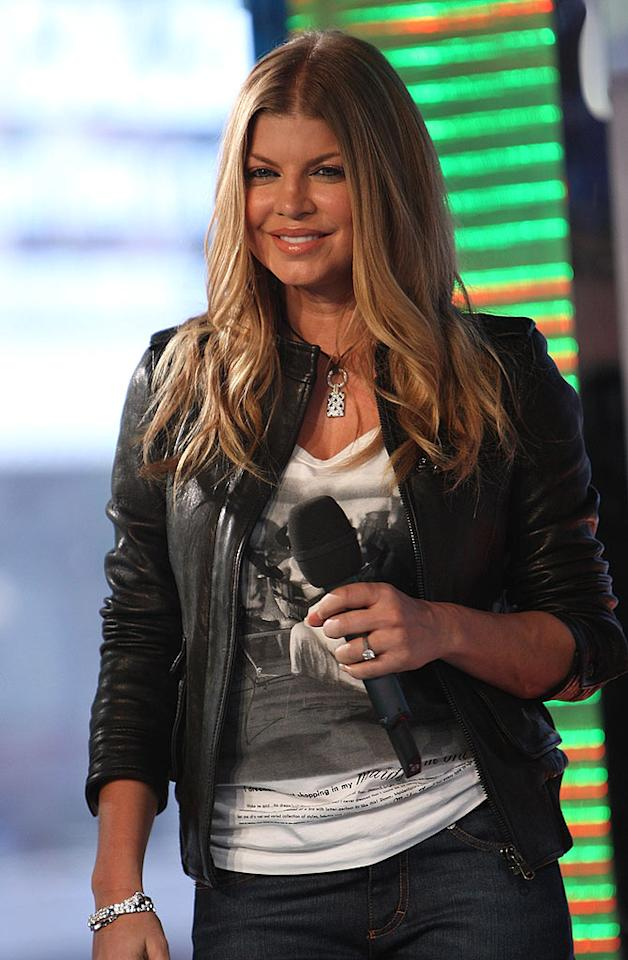 """Instead of being a guest on MTV's """"TRL,"""" Fergie tries her hand at co-hosting the show. Theo Wargo/<a href=""""http://www.wireimage.com"""" target=""""new"""">WireImage.com</a> - April 21, 2008"""