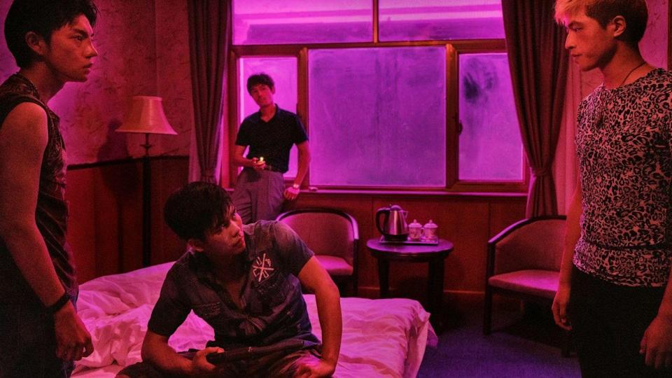 """<p>As with his prior <em>Black Coal, Thin Ice</em>, Chinese director Diao Yinan's <em>The Wild Goose Lake</em> has a coiled intensity that amplifies its romantic fatalism. Diao's neo-noir follows a gangster named Zhou Zenong (Hu Ge) who, after killing a cop in a criminal enterprise gone awry, partners with a """"bathing beauty"""" prostitute named Lu Aiai (Gwei Lun Mei) in order to reunite with his estranged wife Yang Shujun (Wan Qian), all so she might collect the reward on his head. Rife with betrayals, manhunts and shootouts, the auteur's narrative is constantly taking sharp, unexpected turns, and the same is true of his breathtaking direction, which reveals unseen figures, and twists, via elegant camerawork and expressionistic flourishes that are married to a realistic depiction of rain-soaked Wuhan and its lawless lakeside communities. Hunted by police captain Liu (Liao Fan), Diao's protagonists are engaged in a deadly game that's played in silence because they all inherently know the rules, and their sense of purpose is echoed by the film itself, which orchestrates its underworld conflicts with bracing precision. Plus, it boasts 2020's most gruesomely inventive use of an umbrella. <br> </p>"""