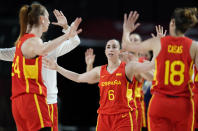 Spain's Silvia Dominguez (6), center, celebrates with teammates during women's basketball preliminary round game against Canada at the 2020 Summer Olympics, Sunday, Aug. 1, 2021, in Saitama, Japan. (AP Photo/Charlie Neibergall)