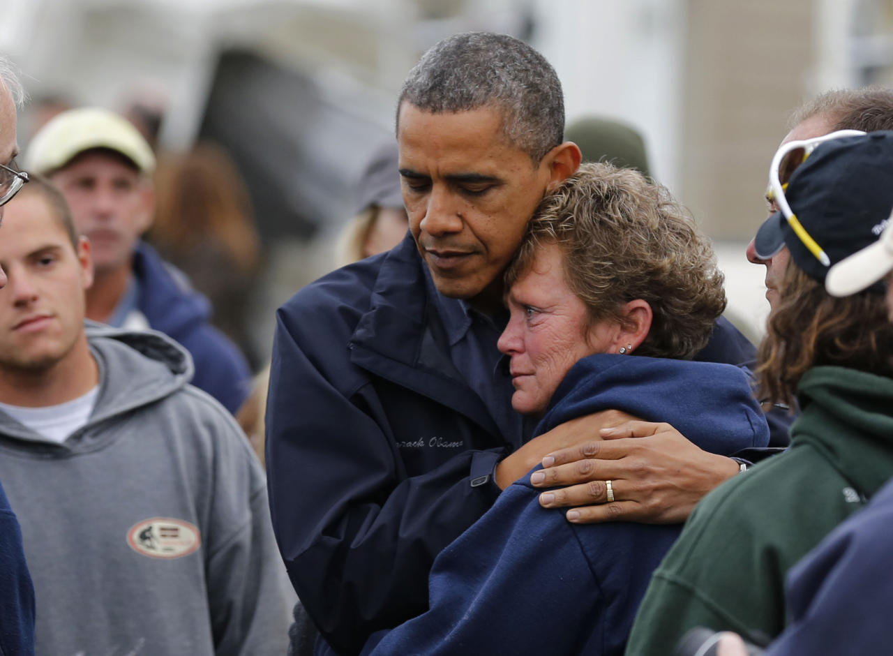 U.S. President Barack Obama hugs North Point Marina owner Donna Vanzant as he tours damage done by Hurricane Sandy in Brigantine, New Jersey, October 31, 2012. Putting aside partisan differences, Obama and Republican Governor Chris Christie toured storm-stricken parts of New Jersey together on Wednesday, taking in scenes of flooded roads and burning homes in the aftermath of superstorm Sandy.   REUTERS/Larry Downing  (UNITED STATES - Tags: POLITICS DISASTER)