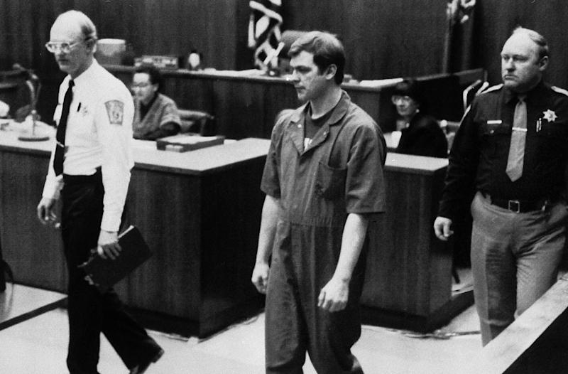 Jeffrey L. Dahmer enters the courtroom in Milwaukee where he changed his plea to guilty but insane in the dismemberment slayings of 15 young males, Jan. 13, 1992. A jury must now determine his mental state at the time of the killings. (AP Photo/Tom Lynn/Pool)