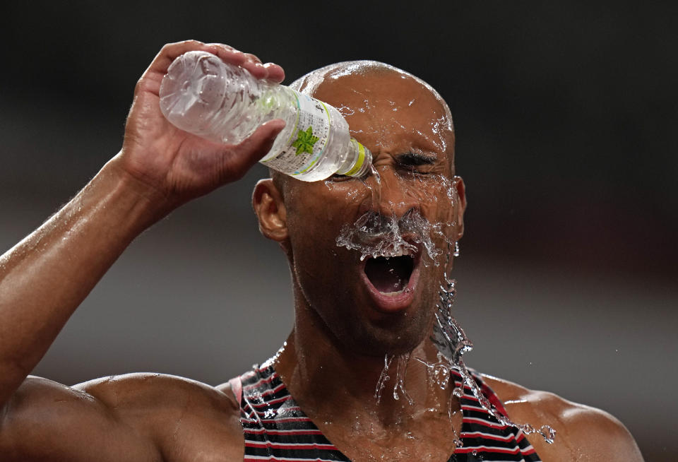 Damian Warner, of Canada douses himself in water as he celebrates after winning the gold medal in the decathlon at the 2020 Summer Olympics, Thursday, Aug. 5, 2021, in Tokyo, Japan. (AP Photo/Francisco Seco)