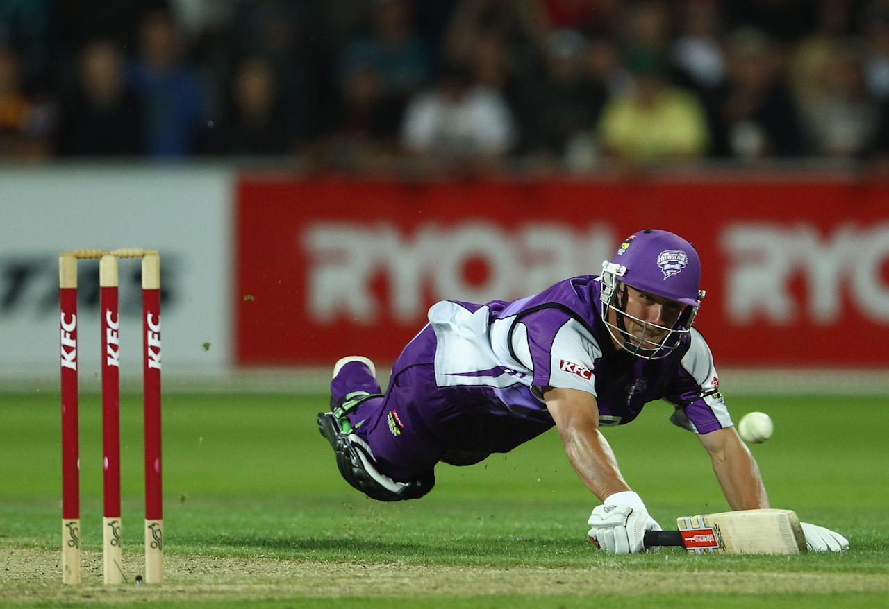 HOBART, AUSTRALIA - JANUARY 22: Matt Johnston of the Hurricanes dives for his crease during the T20 Big Bash League Semi Final match between the Hobart Hurricanes and the Sydney Sixers at Blundstone Arena on January 22, 2012 in Hobart, Australia.  (Photo by Robert Cianflone/Getty Images)