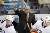 FILE - New York Islanders head coach Barry Trotz stands behind his bench during the first period of an NHL hockey game against the Pittsburgh Penguins in Pittsburgh, in this Tuesday, Nov. 19, 2019, file photo. The four coaches left in the NHL playoffs have connections to each other, but they all took different paths to get to this point. (AP Photo/Gene J. Puskar, File)
