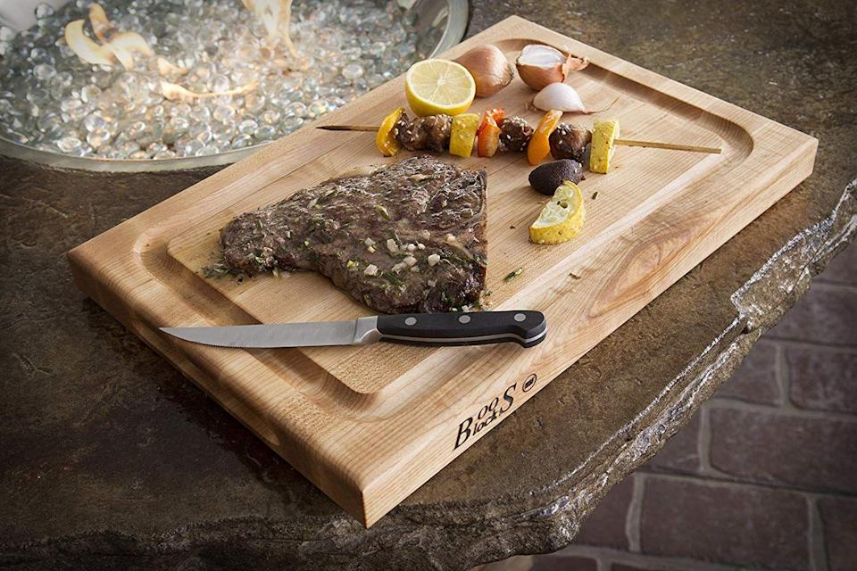 """<h3>The Grilling Dad</h3><p>While your dad probably enjoys spending most of the barbecue by the grill, chances are he's not a huge fan of picking up the post-party mess — and that's exactly where this durable carving board comes into convenient play. The wooden slab boasts a special juice groove for capturing excess liquid plus a bonus surface area for prepping and serving multiple dishes at once.</p><br><br><strong>John Boos</strong> Reversible Maple Wood Edge Grain BBQ Cutting Board , $75.95, available at <a href=""""https://www.amazon.com/John-Boos-Reversible-Cutting-Groove/dp/B00063QBEU"""" rel=""""nofollow noopener"""" target=""""_blank"""" data-ylk=""""slk:Amazon"""" class=""""link rapid-noclick-resp"""">Amazon</a>"""