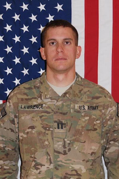 This undated photo provided by Fort Carson(Colo.) shows Army Capt. Joshua Lawrence. U.S. Army Capts. Lawrence and Drew Russell were inside a small command post on an Afghan army base, when an exploding grenade was followed in seconds by bursts of gunfire. Before any of the Americans could raise a hand to defend themselves, Lawrence was dead, one 5.56mm bullet to the head, and Russell was dying, shot three times in the back. (AP Photo/Fort Carson)