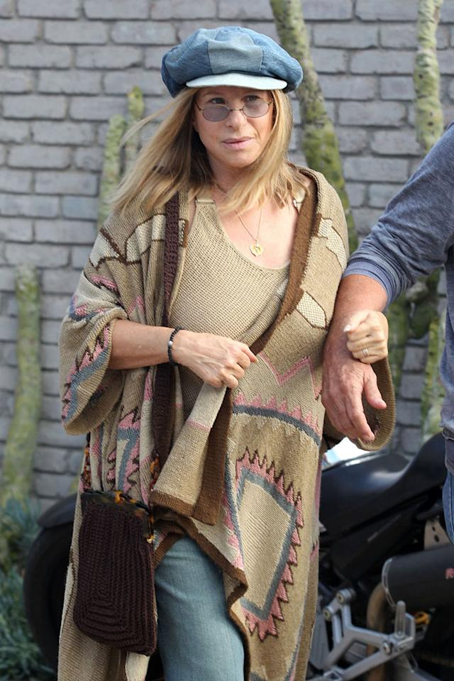 """Is it just us, or do Barbra Streisand's shirt, sweater, and satchel all look like floor coverings you'd find in a sale bin at Ikea? Andrade/Smith/Steinberg/<a href=""""http://www.pacificcoastnews.com/"""" target=""""new"""">PacificCoastNews.com</a> - May 31, 2010"""