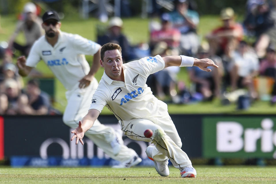 New Zealand's Matt Henry fields the ball off his own bowling during play on the first day of the second cricket test between Pakistan and New Zealand at Hagley Oval, Christchurch, New Zealand, Sunday, Jan 3. 2021. (John Davidson/Photosport via AP)