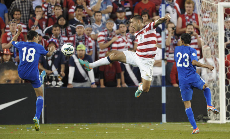 U.S. forward Clint Dempsey leaps for the ball between Guatemala midfielder Carlos Figueroa (18) and defender Jonathan Lopez (23) during the first half of a World Cup qualifying soccer match in Kansas City, Kan., Tuesday, Oct. 16, 2012. (AP Photo/Reed Hoffmann)