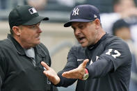 New York Yankees manager Aaron Boone (17) gestures as he loses his temper while complaining about calls with home umpire Chad Whitson, left, during the seventh inning of a baseball game, Thursday, June 3, 2021, at Yankee Stadium in New York. Boone was thrown out of the game. (AP Photo/Kathy Willens)