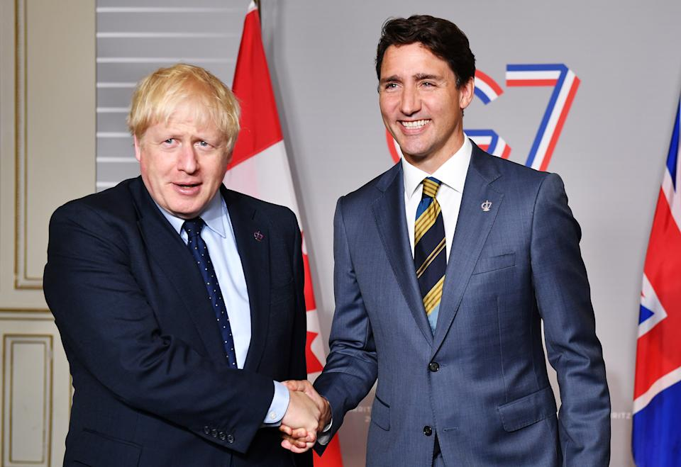 BIARRITZ, FRANCE - AUGUST 24: British Prime Minister Boris Johnson (L) shakes hands with Prime Minister of Canada Justin Trudeau ahead of a bilateral meeting on August 24, 2019 in Biarritz, France. The French southwestern seaside resort of Biarritz is hosting the 45th G7 summit from August 24 to 26. High on the agenda will be the climate emergency, the US-China trade war, Britain's departure from the EU, and emergency talks on the Amazon wildfire crisis. (Photo by Jeff J Mitchell - Pool/Getty Images)