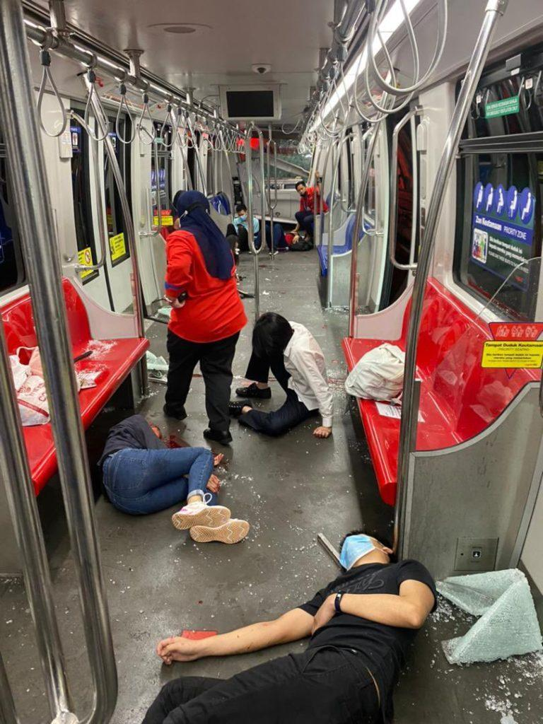 A Prasarana staff member checking on injured passengers. Photo: KL Fire and Rescue Department