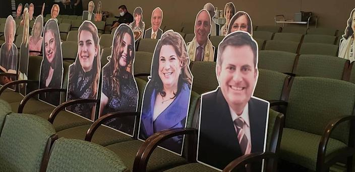 Temple Judea will place cardboard cutouts of congregants on the seats in the sanctuary ahead of High Holy Day services.