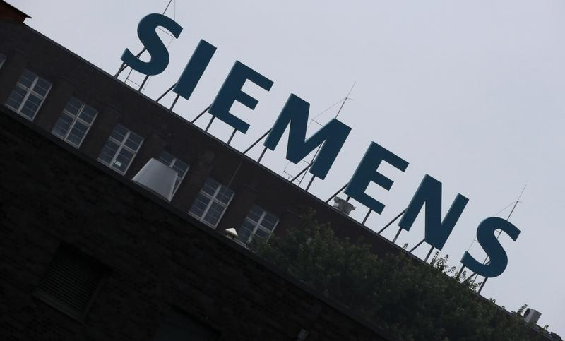 The logo of Siemens AG is seen atop a factory in Berlin